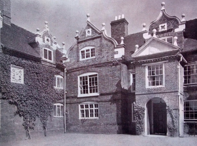 THE ENTRANCE FRONT WITH THE KITCHEN AND BREW-HOUSE WING ON THE LEFT