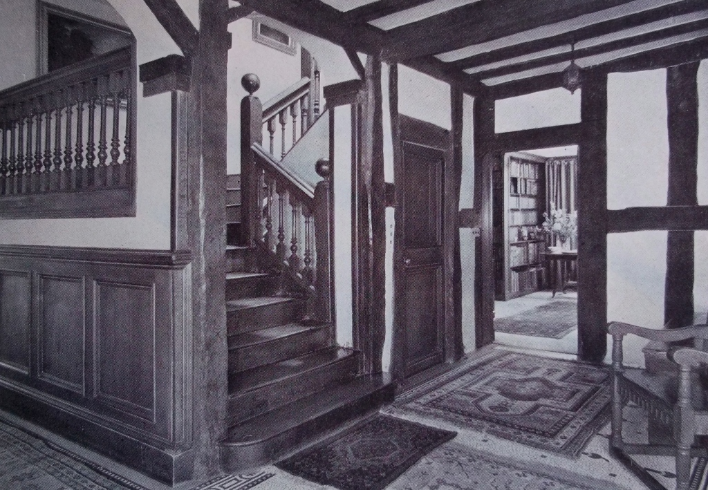 THE FOOT OF THE CAROLEAN STAIRCASE IN THE SOUTH EAST CORNER OF THE HALL