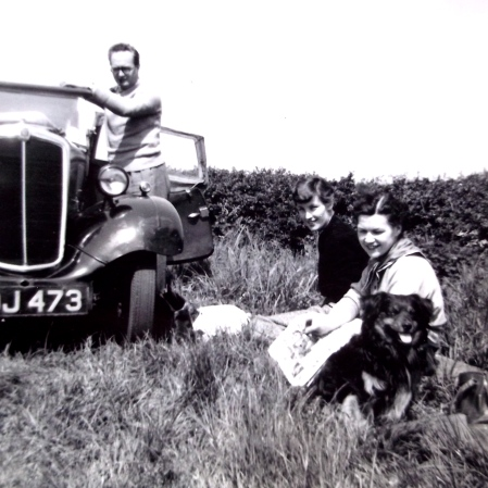 "Ron and Betty Mowday, their dog Bunty, and Mother with her ""Italian Boy Haircut"""