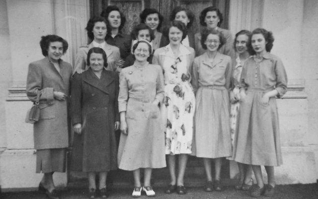 The staff of the Walsall branch of Dorothy Perkins in the early 1950s.  A young Irene Sheldon, second row, left, has one hand on the shoulder of Mrs. Rathbone, the cleaner.  Mrs. Brown, manageress, is at the front.